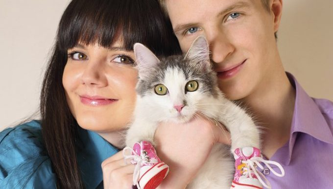 couple with cat in shoes
