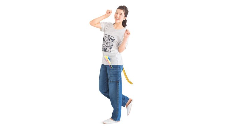 A model shows off the jeans with her hands up like a cat.