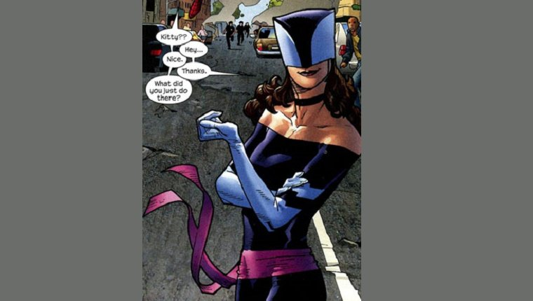 Kitty Pryde stands on a busy street with smoke in the background