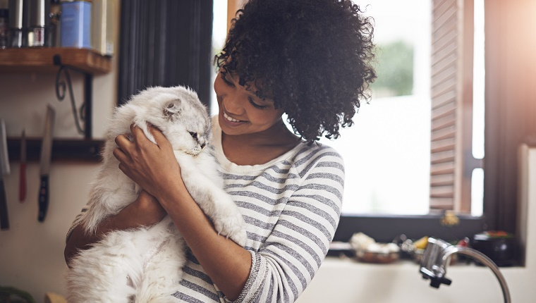 Shot of a young woman enjoying a cuddle with her cat